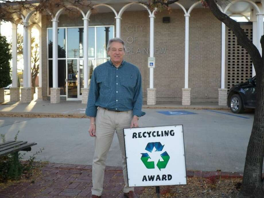 Courtesy PhotoPlainview City Manager Greg Ingham displays the Recycling Award that will be displayed outside Plainview City Hall throughout the month in recognition from the Keep Plainview Beautiful Committee for the city's recycling efforts.