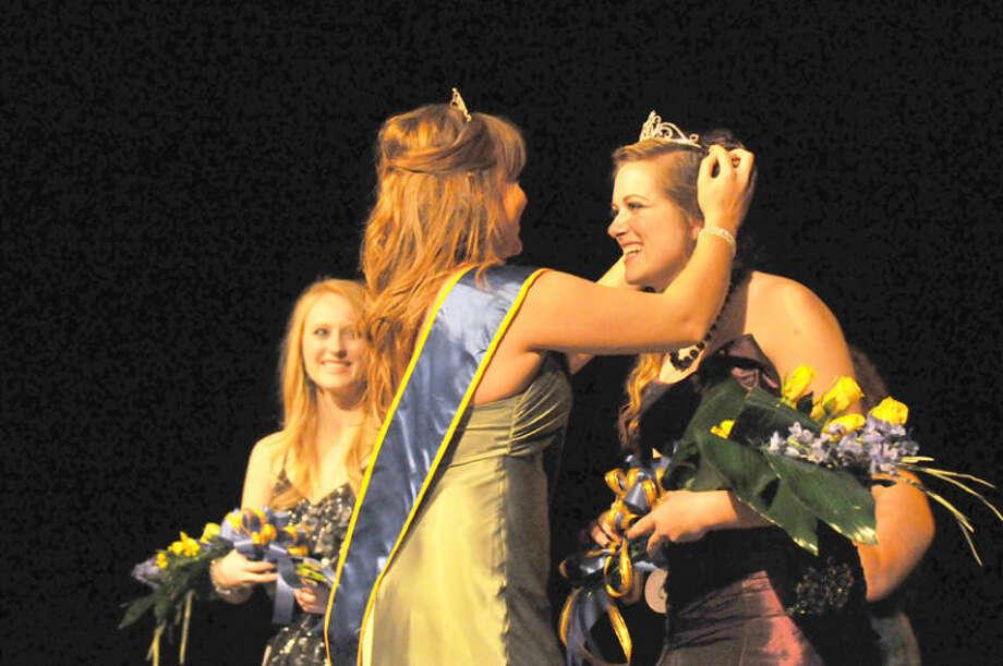 Wayland Baptist University PhotosMiss Wayland 2013 Amanda Page of Plano places a crown on Nicole Adams who was named Miss Wayland 2014 last Saturday.