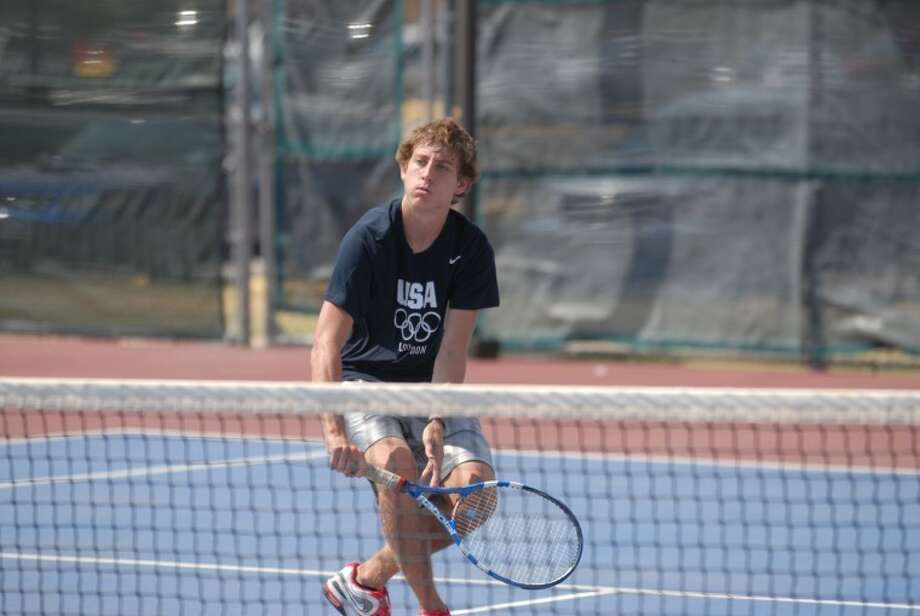 Plainview High junior Andrew Cunningham sends one over the net during a quick tennis match at two-a-day workouts. Photo: Homer Marquez/Plainview Herald