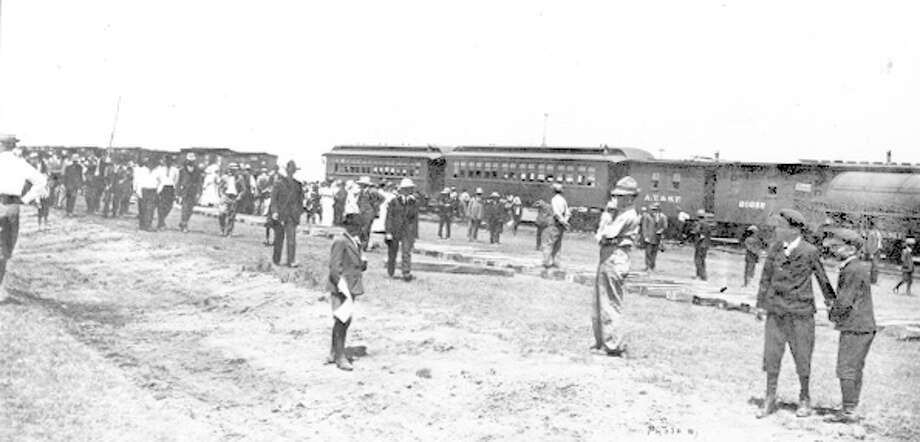 On July 14, 1909, the first train to arrive in Hale Center was recorded in this photo. A big crowd gathered for the event, as well as for a more formal two-day celebration a week later. The train was a Santa Fe and followed the arrival of the railroad into Plainview by about 30 months.