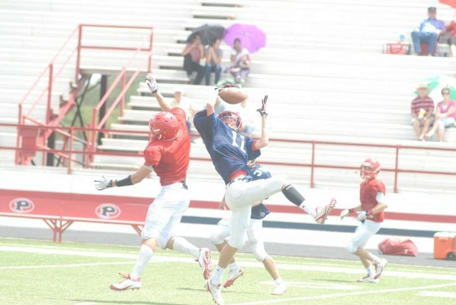 Plainview's Brooks Cannon (11) intercepts a pass intended for a Perryton receiver during last Saturday's scrimmage at Greg Sherwood Memorial Bulldog Stadium. After a Meet the Bulldogs event at 8 p.m. today at the stadium, the Dogs scrimmage Tascosa in Amarillo at 7 p.m. Friday. Plainview opens the regular season a week from today on the road against Estacado.