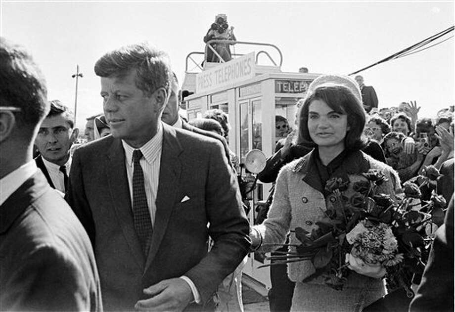 FILE - In this Nov. 22, 1963 file photo, President John F. Kennedy and his wife, Jacqueline Kennedy, arrive at Love Field airport in Dallas, as a television camera, above, follows them. More than a dozen new documentary and information specials are among the crop of TV commemorations pegged to this half-century mark of a weekend when, as viewers will be reminded again and again, everything changed. (AP Photo/File) Photo: Uncredited / AP