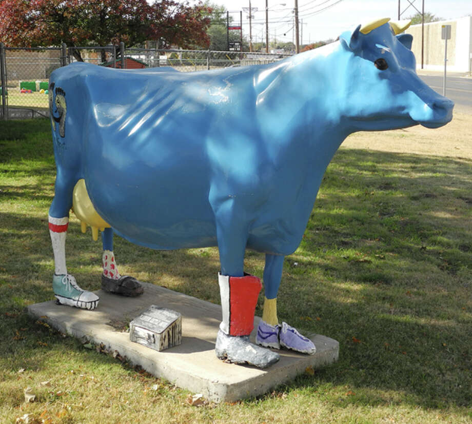 """Happy Hoofer,"" sponsored by Soroptimist International of Plainview, stands at Wee Care Child Center symbolizing the many shoes that have been given to children through the Happy Feet program. Photo: Gail M. Williams 