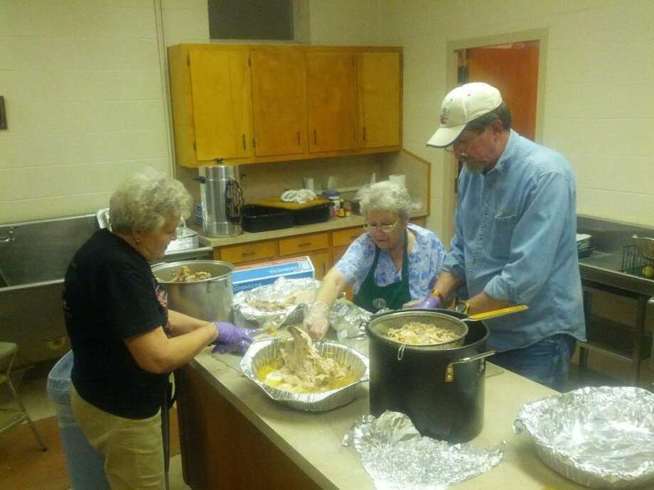 From left, Evelyn Ball, Elvira Arellano and Joe Rogers, members of the St. Alice Catholic Church, shred turkeys Wednesday in preparation of today's 84th Annual turkey dinner. Plates are available for $8 at the church, located at 12th and Galveston Street, from 5-7 p.m. at the drive-thu. Photo: Homer Marquez/Plainview Herald