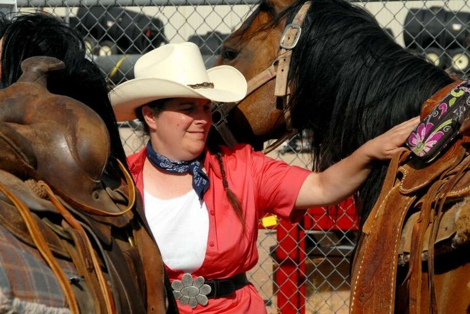 Christine Haynes gets horses ready for the parade in Petersburg on Saturday. Photo: Richard Porter/Plainview Herald