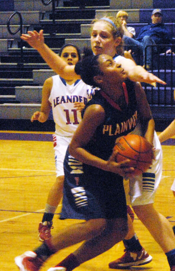 Plainview's Taivia Hearn tries to get to the basket in a game against Leander at the Marble Falls Tournament Friday. The Lady Bulldogs split four games and finished sixth in the three-day event. They lost to Wall 43-41 in overtime in the fifth-place game Saturday. They will return to action Tuesday when they travel to Lubbock Cooper for a 6 p.m. game. Photo: Doug McDonough/Plainview Herald