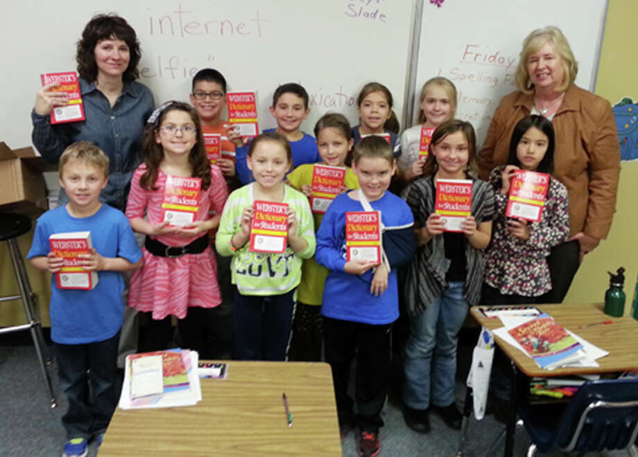 Teacher Pam Hinze (right) and Principal and Rotarian Karen Earhart (left) join the Plainview Christian Academy third-grade class with their new dictionaries. The Plainview Rotary Club presents a new dictionary to every third grader in Hale County each year to support improved literacy in our schools. Photo: Dr. Charles Starnes | Courtesy Photo