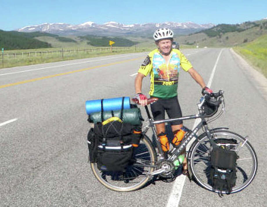 Keith Reed takes a breather while on his ultimate summer adventure, pedaling across the northern United States. Reed, 50, is a native of Hart now living in Perkins, Okla.