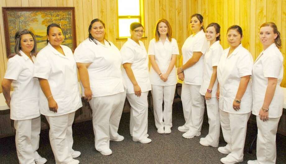 South Plains College Plainview Center pinned 14 vocational nurse graduates (above) during a ceremony last week at the Ollie Liner Center, including Cassandra Chavez (left), Pamela Barenas, Jessica Cervantes, Diana Flores, Lindsey Acker, Elisa Medina, Kendra White, Cynthia DeLaCruz and Jenna Sewell. Missy Ballejo of Kress, Sara Quintero and Alex Jara-Gonzales of Hale Center, Cyrilla Robb of Nazareth and Deborah Soto of Lorenzo completed the graduating class. Photo: Wes Underwood South Plains College