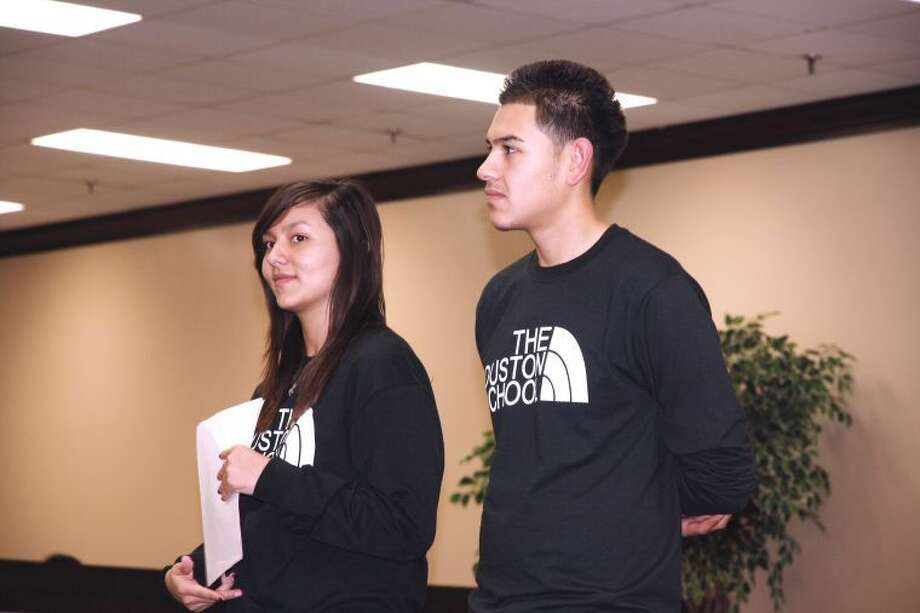 Jan Seago/Plainview ISDStudent Council President Steven Guillen (right) and Vice President Priscilla Duran wait to address the crowd gathered at the Houston School's parent meeting.