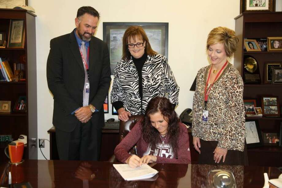 Jan Seago/Plainview ISDPlainview High School senior Jaci Marley (seated) signs a national letter of intent with Texas A&M University on Monday as a SEC NCAA Division I athlete in women's equestrian. Looking on are PHS principal Tye Rogers, Jaci's mother Jennifer Marley, and senior counselor Valinda Parker.