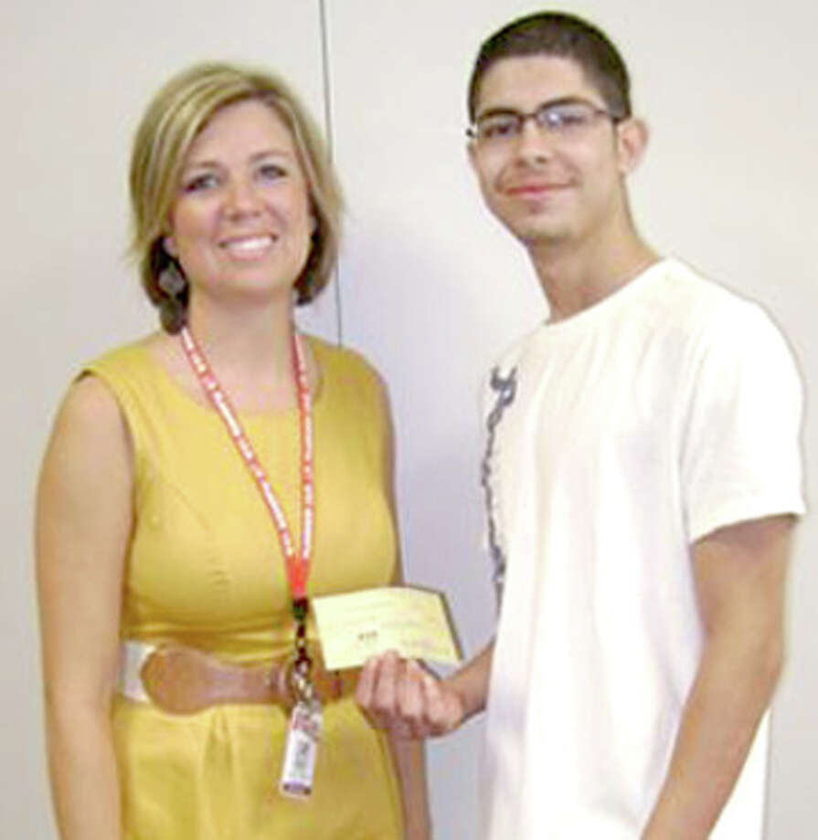 Hillcrest Elementary Assistant Principal Amy Meeks presents Brandon Tijerina a $250 check after he received the Inez Wade Memorial Scholarship given by the Hillcrest PTA. Tijerina is a PHS graduate and former student at Hillcrest. Photo: Laura Larralde Hillcrest Elementary