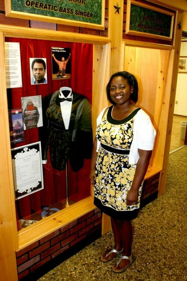"Jonathan Petty/Wayland Baptist UniversityChristal Patterson, senior voice major at Wayland, visits a display featuring Terry Cook at the Museum of the Llano Estacado. Patterson will sing three arias from ""Porgy and Bess"" with Cook and the Plainview Symphony orchestra Thursday evening."