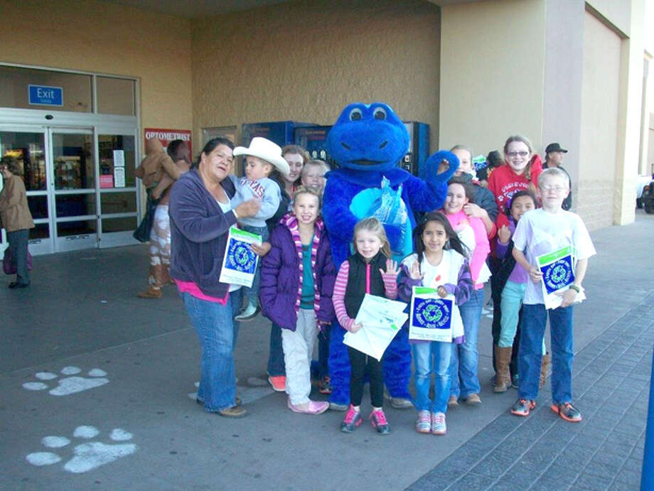 "Buster Perry/City of PlainviewLarry Perez, the ""Trashasaurus,"" along with Keep Plainview Beautiful and Hale County 4-H members distributed recycling information packets at Walmart Supercenter earlier this week in observance of America Recycles Day. The packets contained coloring books, rulers, pencils and crayons which were donated by the City of Plainview Recycling Center. Colti Wright, Plainview 4-H Club member, was chairman for the event."