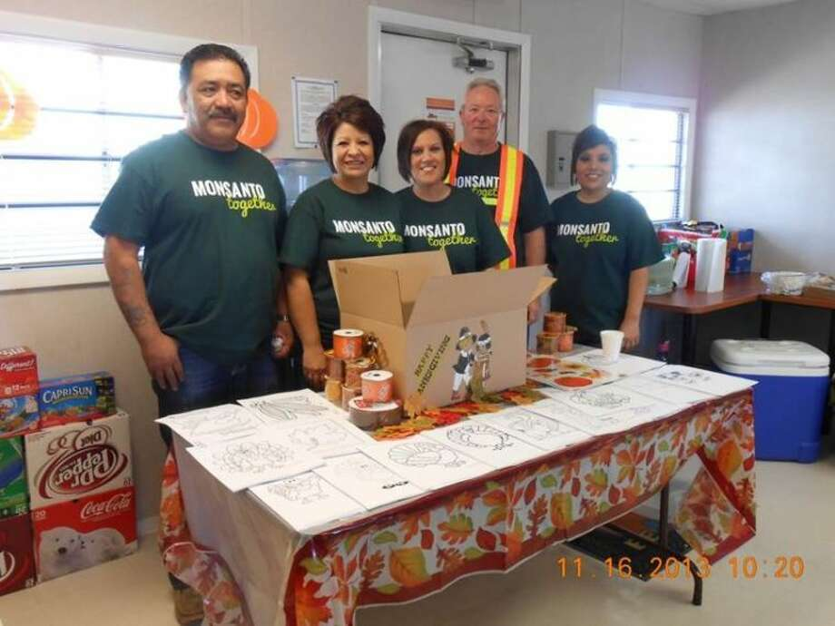 Courtesy PhotoEmployees of the Aiken branch of Deltapine Monsanto work to raise money to fund Thanksgiving food boxes for Rural Hunger Volunteer Month. The Deltapine site was able to surpass its goal by raising $1,354, which made 84 boxes.