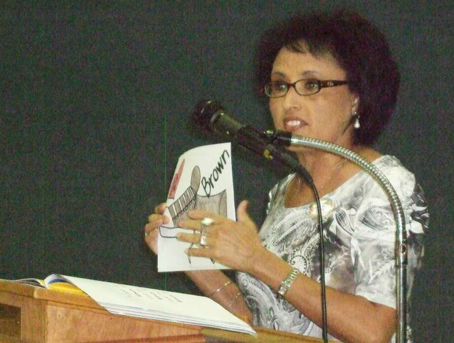 "Yolanda Vera reads and sings ""Pete the Cat: I Love My White Shoes"" at the Read First Kickoff Luncheon held Thursday. Photo: Gail M. Williams 