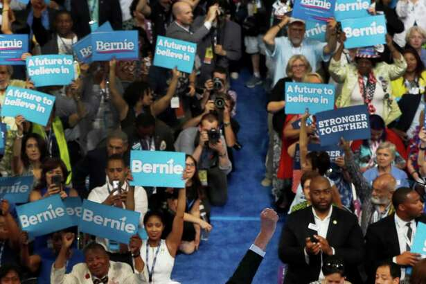 Former Democratic presidential candidate, Sen. Bernie Sanders, I-Vt., pumps his fist in the air as he addresses the first day of the Democratic National Convention in Philadelphia , Monday, July 25, 2016.