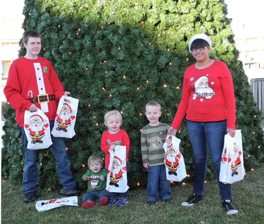 4-H members will help Santa distribute gift bags at Breakfast with Santa at the Ollie Liner Center. Jonathon Farmer is the helper at left, and Beatrice Rodriguez is the helper at right. Kleat Barrett (left), Colt Barrett and Alex Farmer are waiting for Santa. Photo: Gail M. Williams | Lifestyles Editor