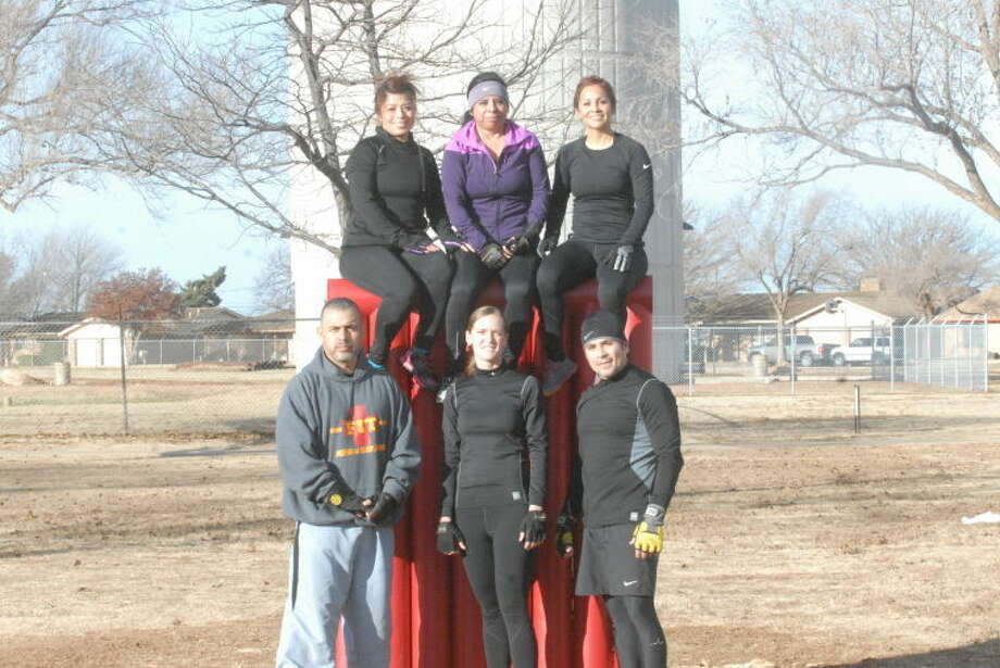 Members of F.I.T Plainview train in the early morning as they prepare for a 12-mile extreme obstacle course known as the Spartan Race. Pictured on top are Tiffany Amador, Becky Balderas and Stephanie Balderas. Bottom from left is Al Longoria, Misty Valles and Manuel Balderas. Not pictured but competing in the race are Jamie Salinas, Robert Gallardo, Kaleb Ty and Sarah Reyna. Photo: Homer Marquez/Plainview Hearld