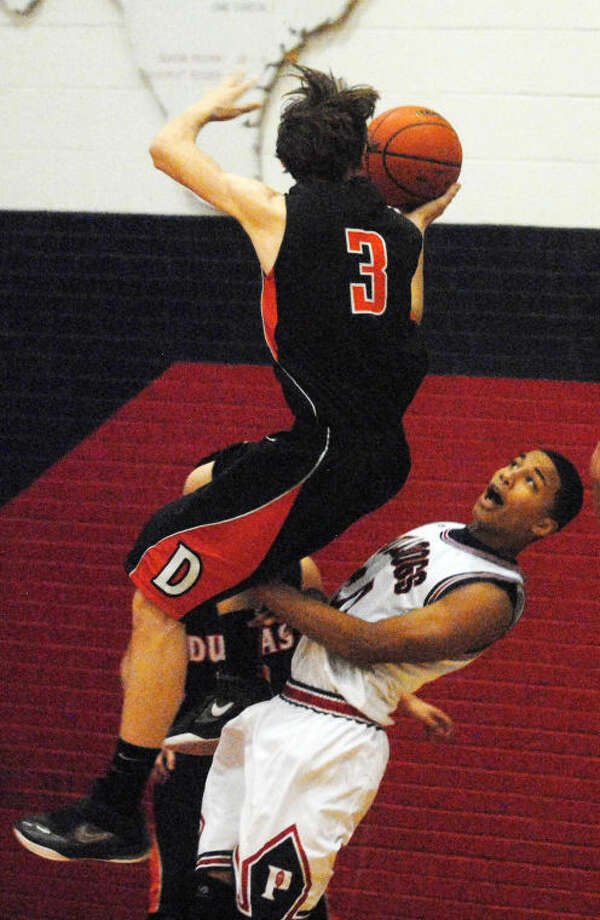 Plainview's Zach Riddley draws an offensive foul on a Dumas player during a boys basketball game Tuesday night. Photo: Skip Leon/Plainview Herald