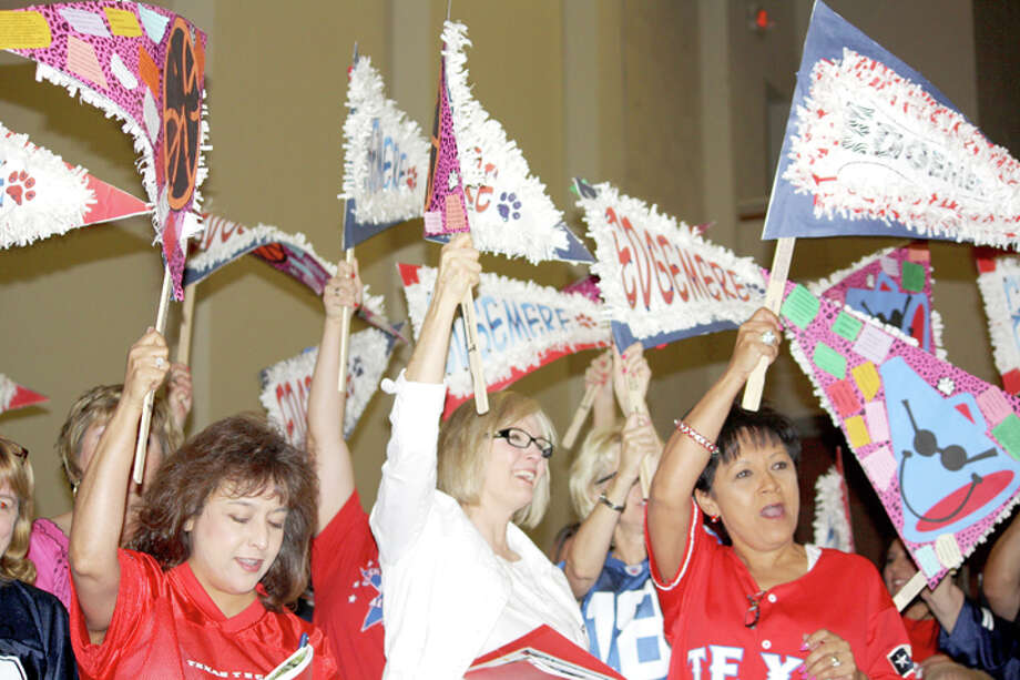 Jan Seago/Plainview ISDEdgemere teacher Barbara Ramirez (left), counselor Cynthia Oles and teaching Assistant Principal Angie Valdez join coworkers in cheering as Edgemere staff is introduced Monday during opening ceremonies for the school year. Photo: Jan Seago/Plainview ISD