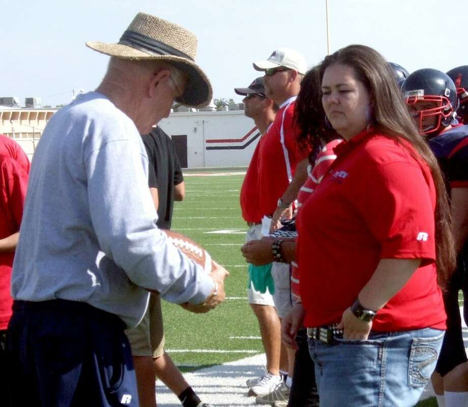 New PHS athletic trainer Valerie Duran, seen her talking to veteran assistant coach Neil Billingsley on the sidelines at Greg Sherwood Memorial Bulldog Stadium, formerly worked for an indoor football team in Alaska as well as the Fort Worth Cats baseball team.
