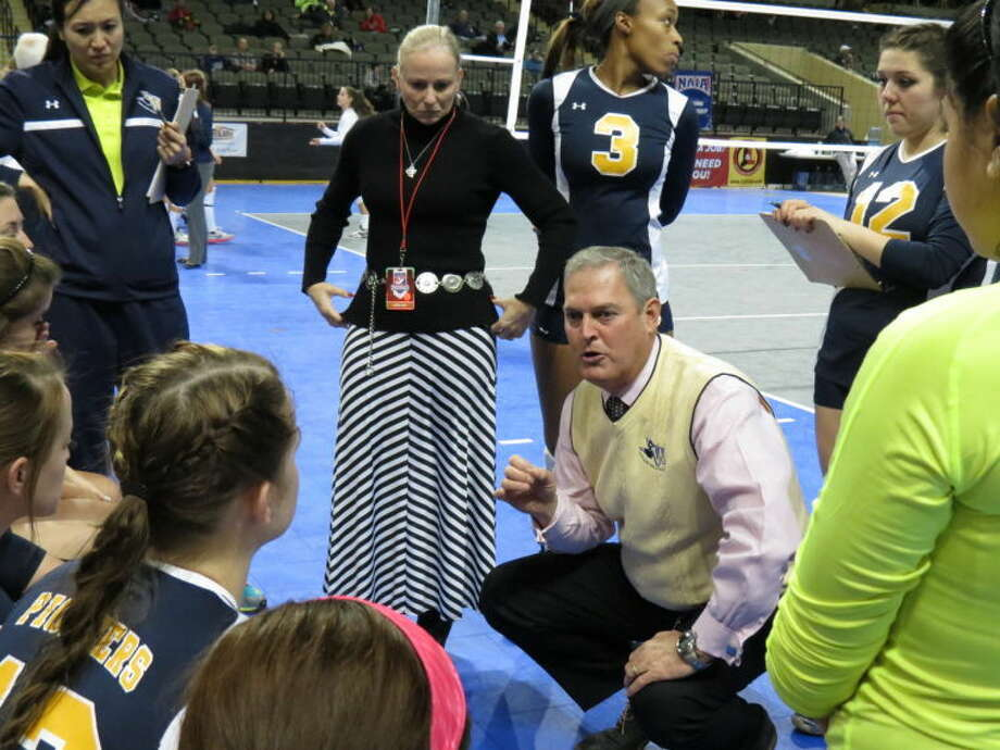 Wayland Baptist volleyball coach Jim Giacomazzi talks to his team during a timeout at the NAIA Volleyball National Championships in Sioux City, Iowa. Also shown are Giacomazzi's wife and volunteer assistant, Trish, and Pioneer assistant coach Sarah Ma. The No. 19 Pioneers, after sweeping No. 9 Vanguard (Calif.) on Tuesday, swept No. 5 Northwestern (Iowa) on Wednesday. WBU plays No. 23 Spring Hill (Ala.) at 5:45 p.m. today to conclude pool play, and the Pioneers already have qualified as one of 12 teams to advance to single-elimination bracket play beginning Friday morning. Photo: Photo Courtesy Of Wayland Baptist University