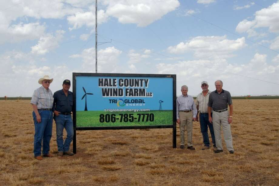 Tri Global Energy representative Curtis King (third from right) is joined by Hale County Wind Farm managers O.A. Stout Jr. (left), Mike Price, Rocky Buckner and Lanny Voss at the site of the farm's primary meteorological tower east of Hale Center. The tower has been gathering wind data for two years and now is having that data backed up by two more MET towers that were installed about five months ago. The farm contains about 47,000 acres of the 70,000 acres to be leased. Photo: Richard Porter/Plainview Herald