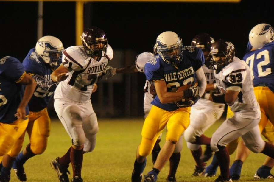 The Hale Center Owls' Max Belyeu (center) runs through a hole during the Owls' game against the Bovina Mustangs on Friday in Hale Center. Photo: Eli Camargo/For The Herald