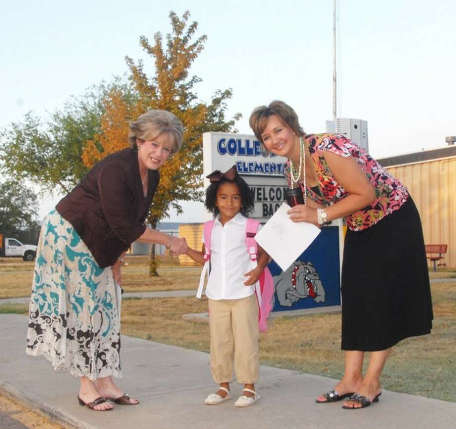 College Hill Principal Linda Watson (left) and Assistant Principal Bilinda McCutcheon greet 5-year-old Mady Williams upon arrival Monday morning for her first day as a kindergarten student. Photo: Doug McDonough | Herald Editor