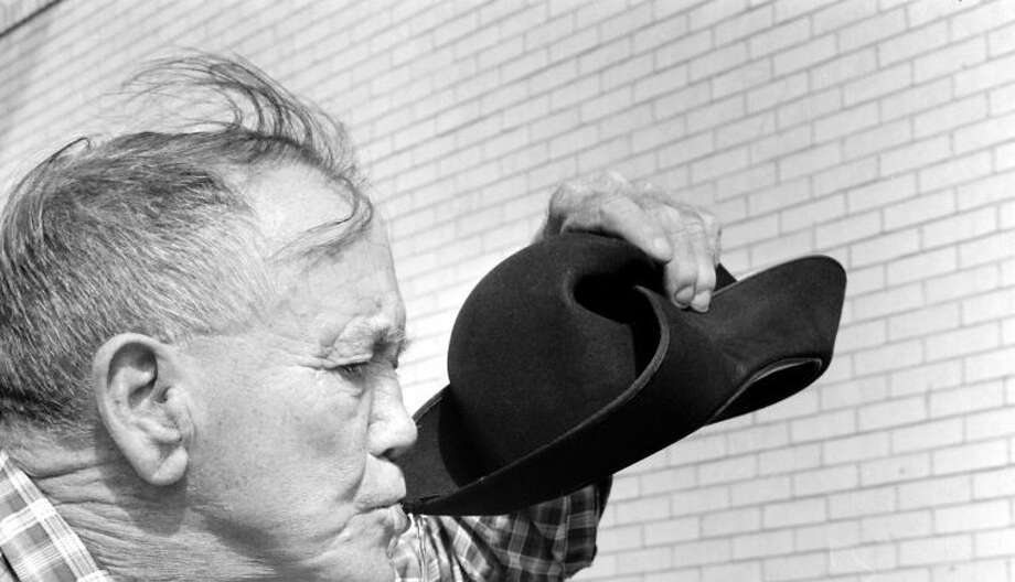Herald File PhotoColeman Jones in 1963 demonstrates show an authentic cowboy drank water from his Stetson, by curling the wide brim and scooping up as much as a quart of water.