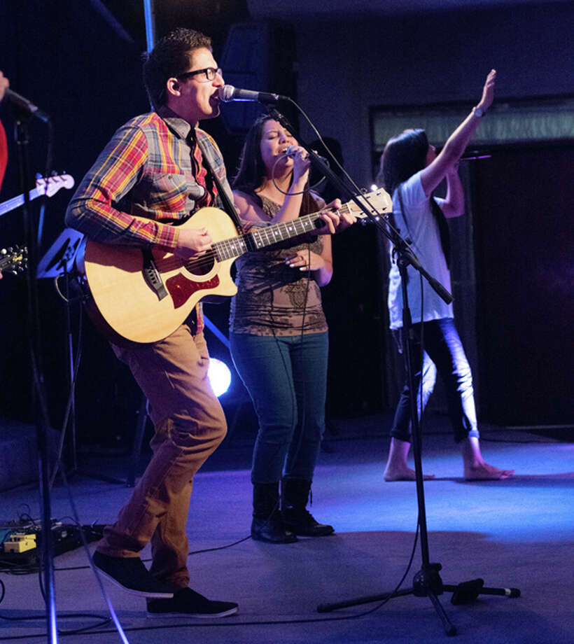 Steven Martinez (left), Josie Galvan and Raquel Chavez practice one of the songs to be performed during New Life Assembly of God's Christian musical festival to be held at the Fair Theatre Friday evening. The free concert is their Christmas gift to local audiences. Photo: Courtesy Photo
