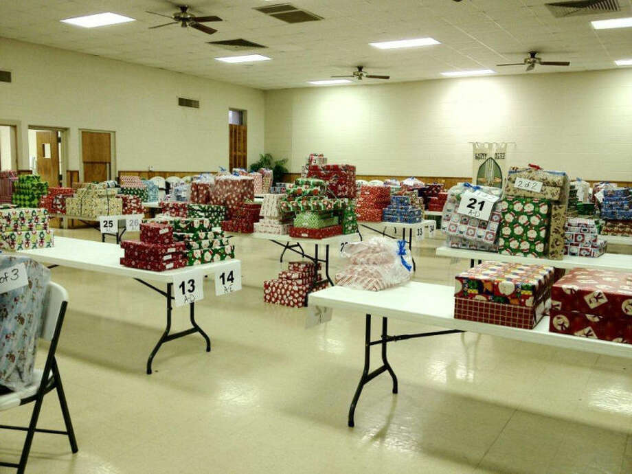 The Junior Service League has gifts wrapped and ready for Plainview children. Past president Ana Borrego said the League serves from 200-250 children each year. Photo: Silvia Zahn | Courtesy Photo