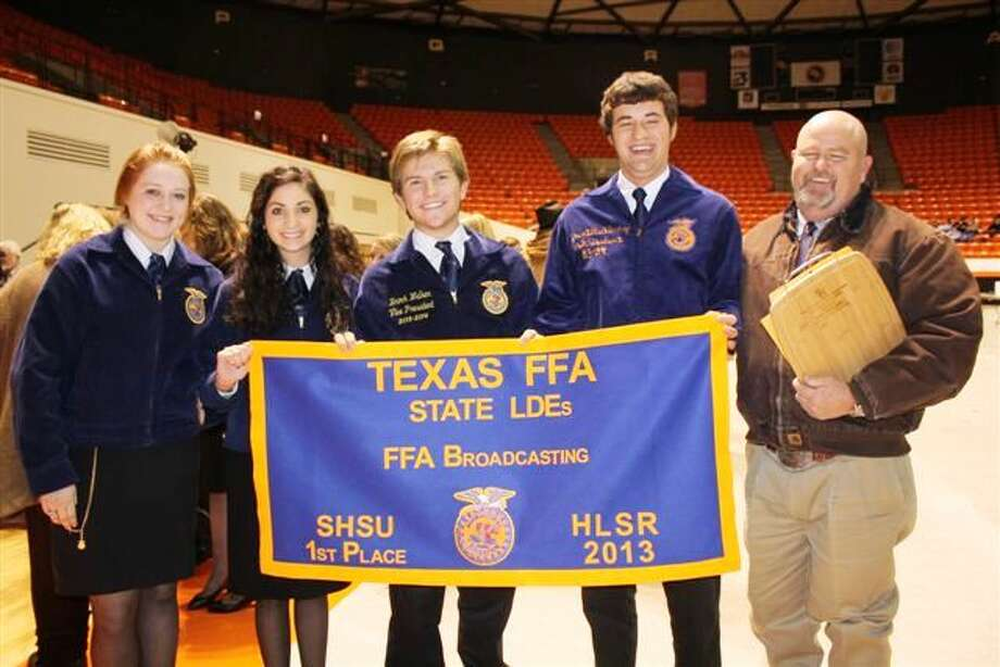 Plainview FFA radio broadcasting team members Emily Williams (left), Madi McKay, Brock Walker, Jacob Richburg and adviser Rick McKay display the first place banner the group earned at the state FFA Leadership Career Development Event. The team placed first in the state against 675 teams.