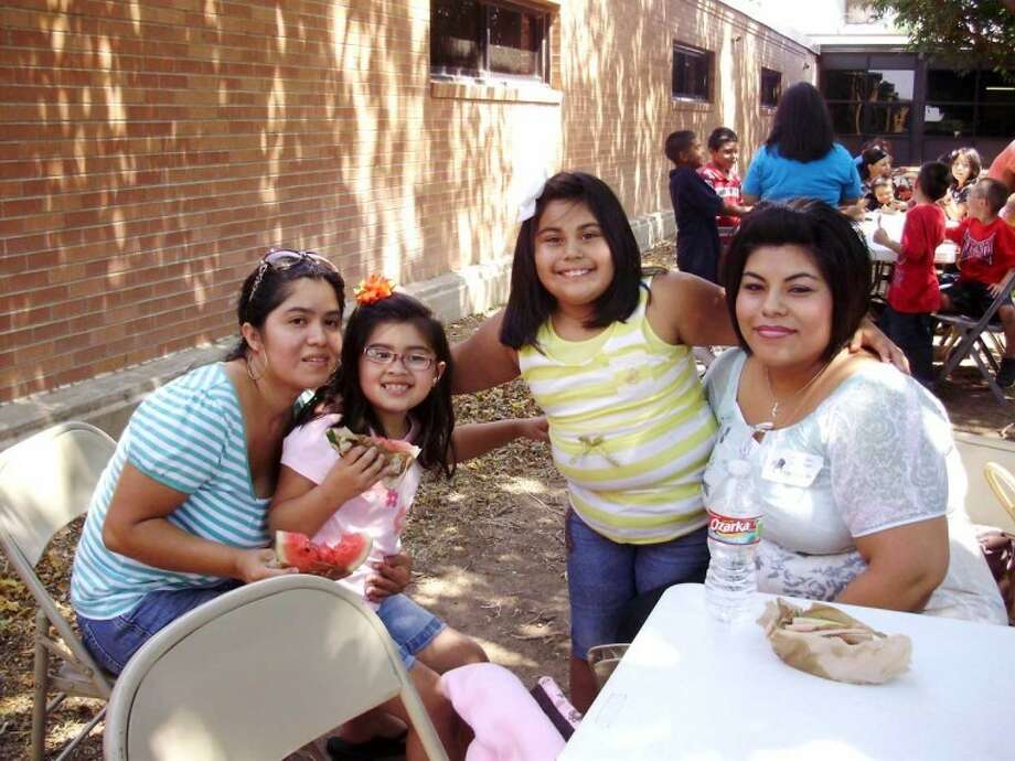 Second-grade students at College Hill Elementary marked the end of their first week of the new school year Friday with a watermelon celebration. Parents were invited to visit their child's classroom prior to joining the students outdoors for watermelon. Among those joining in the celebration were Kimberth Armas (left) and daughter, Erika, and Carmela Enriquez and daughter, Lizzete. Second-grade teachers are Kelly Mendoza, Jennifer Havens and Linda Ray. Photo: Courtesy Photo