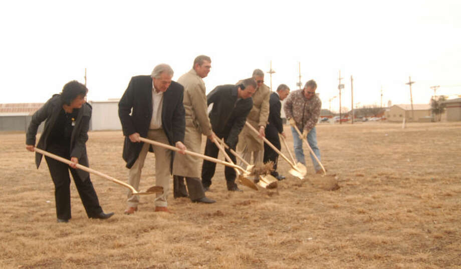 "Despite chilly temperatures, scores of local individuals joined with South Plains College officials on Thursday to break ground for the new SPC-Plainview Technology Center. Handling the gold shovels for the formal groundbreaking of the $1 million project are Gracie Quinonez (above left), SPC-Plainview director; Plainview City Manager Greg Ingham; Dr. Kelvin Sharp, SPC president; Ted Baker, Walmart Distribution Center Transportation; Plainview Mayor Wendell Dunlap; Jim Walker, SPC academics vice president; and Jim McCutcheon, project manager. At right, Sharp told those gathered that the new ""world class training center is a dream come true. ""He was president nine years ago when the local campus opened. Photo: Doug McDonough/Plainview Herald"
