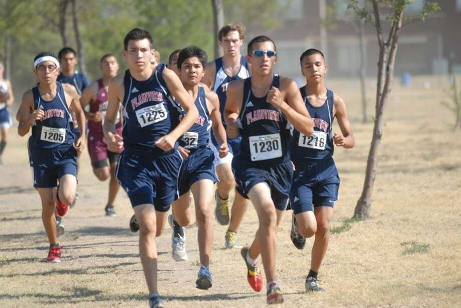 On Saturday, the Bulldogs took home the title during the ATM2GO cross country meet in Plainview. Jarel Rosas lead the pack finishing the three-mile course in 16:59. Bulldogs Christian Garcia finished with a time of 17:26; Chris Salinas with a time of 17:40 and Joey Gonzales with a time of 17:53. Photo: Homer Marquez/Plainview Herald