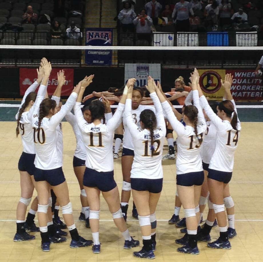 Members of the Wayland Baptist Pioneers break their huddle prior to a match at last week's NAIA Volleyball National Championships in Sioux City, Iowa. Photo: Photo By Mike Wiechmann