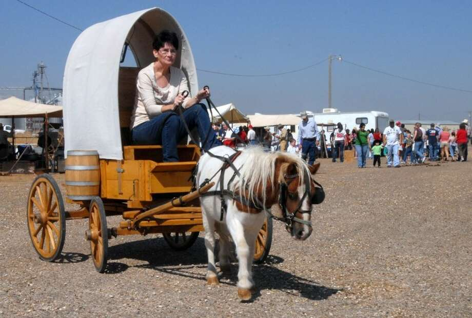 Lee Pitts steers as Cisco pulls this miniature chuck wagon during Plainview's Cowboy Days celebration at the Ollie Liner Center. The wagon was part of Jim Nolan's Exceptional Rodeo and Petting Zoo during the 2001 event, Photo: File Photo