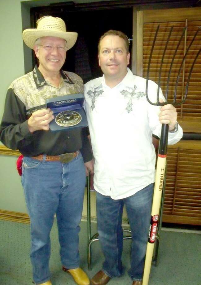 "In this 2010 file photo, Charles ""Salty Dog"" Starnes (left), representing Pakmail Co. of Plainview, shows off the belt buckle he received for winning the Trail Boss Shoot Out Contest and a place at the head of this Saturday's Cowboy Days Parade. Beside him is Anthony Brocato, from PNS/UMC Family Medical Care, with his ""Trail Hand"" pitchfork. As last-place finisher, Brocato will bring up the rear of the cattle drive and parade. Photo: File Phot"