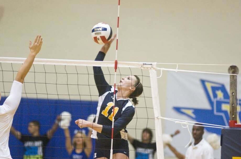 The Wayland Baptist Pioneers' Kimberli Harger gets a kill during the Coca-Cola Classic last weekend. The Pioneers won all three of their matches at the Warrior Challenge at Bacone College this weekend. Photo: Ryan Thurman/Plainview Herald