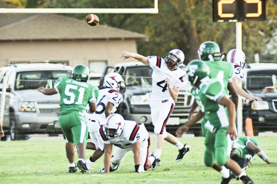 Lockney quarterback Riley Teeter (4) throws a pass during the Longhorns' game against the Floydada Whirlwinds on Friday in Floydada. Floydada won 29-8. Photo: Eli Camargo/For The Herald