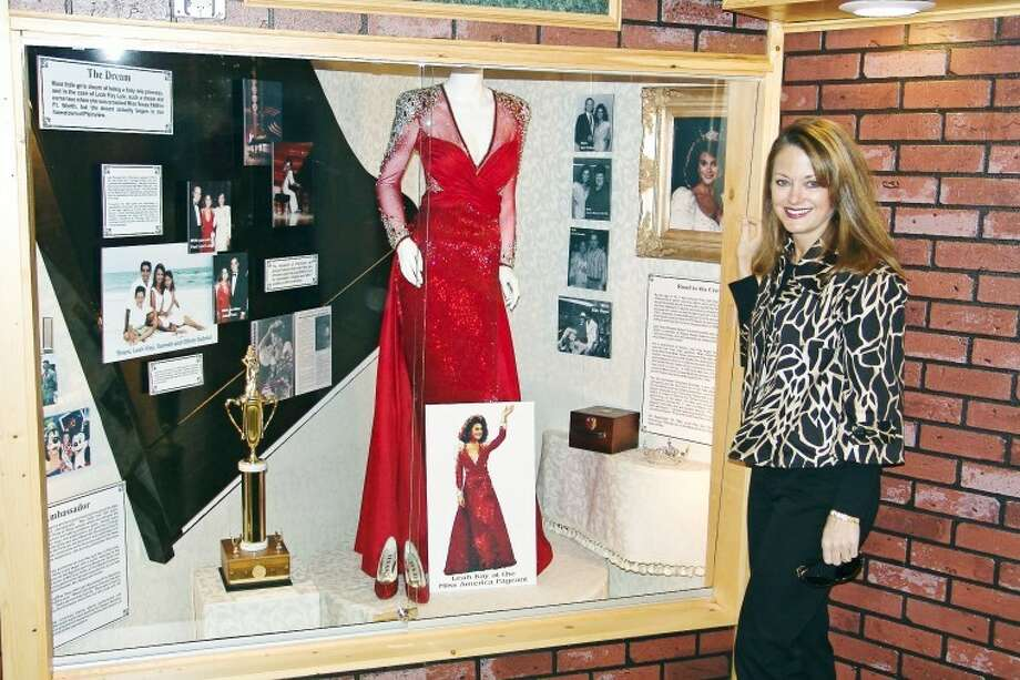 """CourtesyPhotoLeah Kay LyleGabriel stands by her Hale County Hall of Fame exhibit in theMuseum of the Llano Estacado. Gabriel, crowned Miss Texas 1989,will be back in Plainview on Saturday serving as featured performerin """"A Grand Evening,"""" a piano concert celebrating Wayland andSteinway Pianos."""