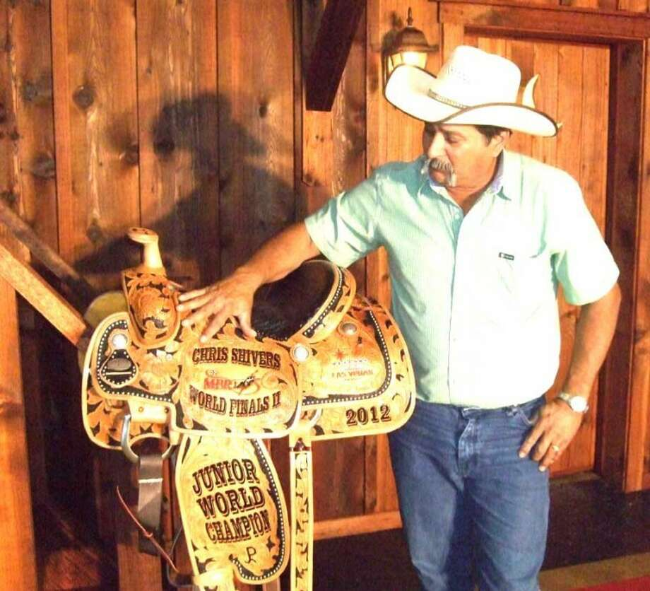 Ciraldo Leal shows off a championship saddle for miniature bull riding to be won in Las Vegas next month at Professional Bull riders World Finals. Photo: Shanna Sissom/Plainview Herald