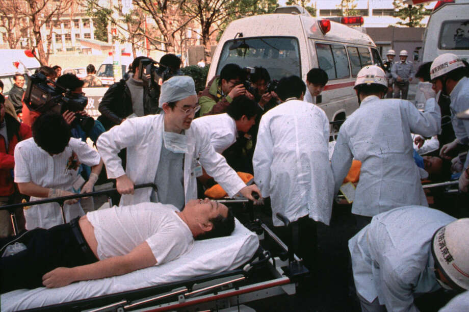 FILE - In this March 20, 1995 file photo, subway passengers affected by sarin nerve gas in the central Tokyo subway trains are carried into St. Luke's International Hospital in Tokyo. Doomsday cult Aum Shinrikyo dispersed sarin nerve gas on Tokyo subway trains and killed 13 people. Photo: Chiaki Tsukumo, AP / A1995
