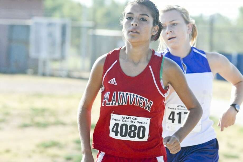 The Plainview Lady Bulldogs' Angelic Guerrero runs during the ATM2GO Cross Country Series held at Running Water Draw Regional Park last Saturday. Guerrero placed 14th in the West Texas Micrographics Invitational at Mae Simmons Park in Lubbock on Saturday. Photo: Ryan Thurman/Plainview Herald