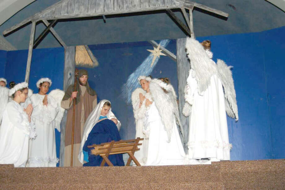 Courtesy Photo/Jim SteiertA heavenly host of angels gathers around the Holy Family in this scene from the beloved Nazareth Christmas Pageant, which will see its 19th staging with performances Dec. 22 and 23 at 7:30 p.m. in the Holy Family Church in Nazareth.