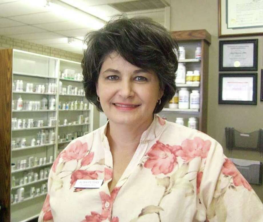 Pharmacist Alisa Peters takes a break Wednesday from filling prescriptions at her new Olton Street store, Hometown Pharmacy.