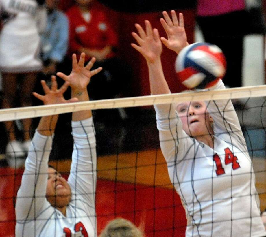 The Plainview Lady Bulldogs' Olivia Tinoco (left) and Bailey Davis attempt to block a Canyon attack during a District 3-4A match Tuesday in the DogHouse. Canyon beat Plainview in four games 25-19, 25-9, 21-25, 25-15. Photo: Richard Porter/Plainview Herald