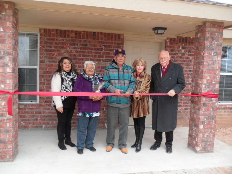 Brad Patrick/South Plains Community Action AssociationSPCAA board member Rosie Rendon (left), homeowners Guadalupe and Manuel Solis, Floyd County Judge Penny Golightly and SPCAA Executive Director Bill Powell take part in Friday's ribbon cutting ceremony.